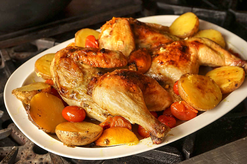 Flattened chicken and roasted potatoes