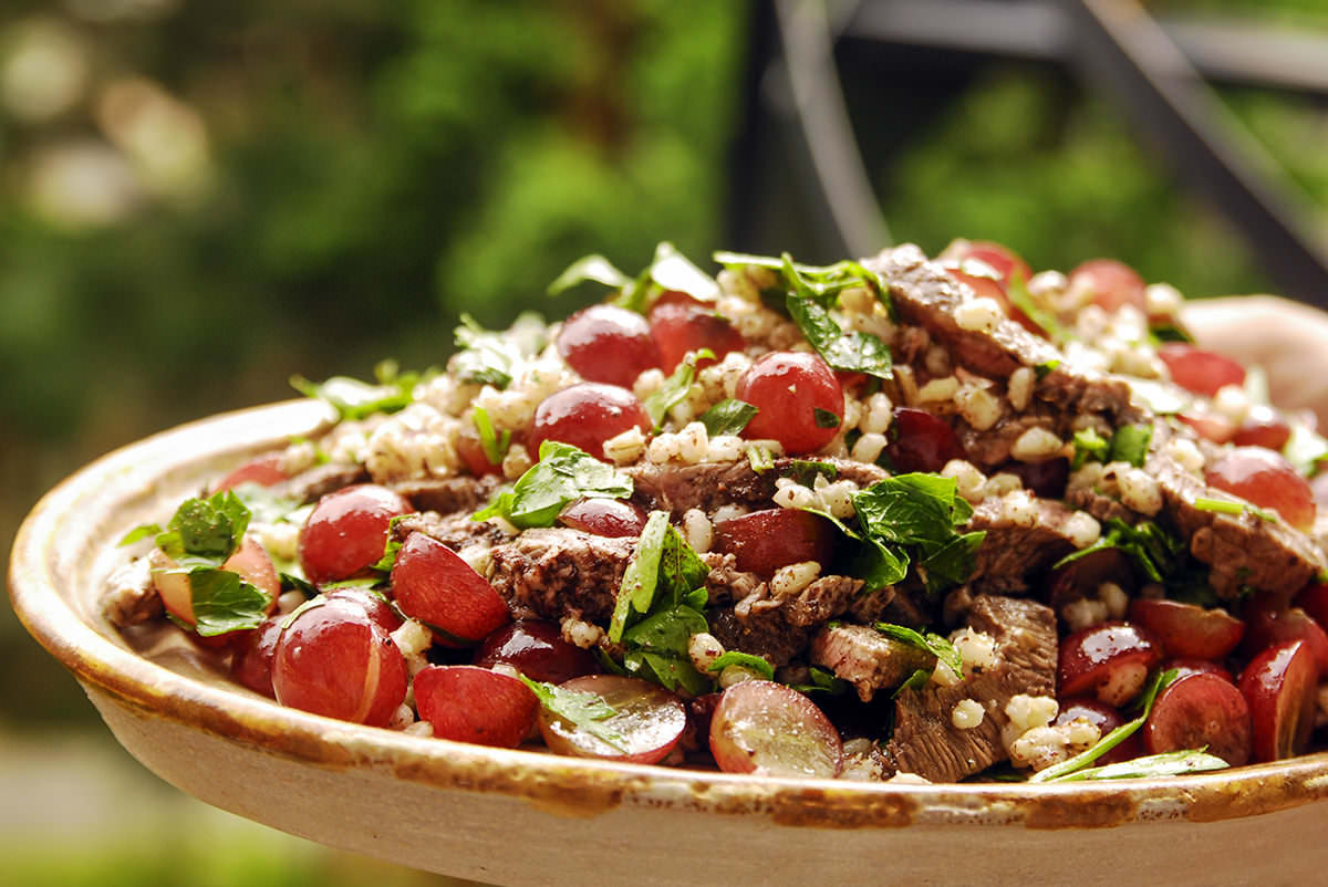 Barley, grape and grilled beef salad